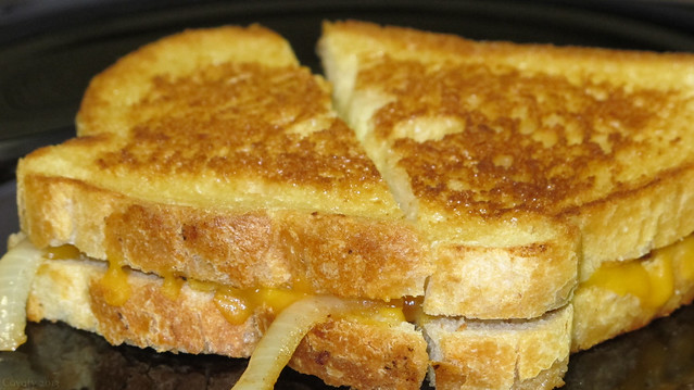 Cheddar and American grilled cheese with sauteed onions