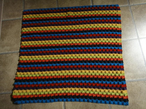 Striped bumpy blanket.