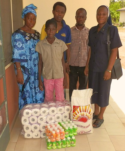 Rachel Ojo SSL (right) from the Orogun community in Nigeria visits a local remand centre in Ibadan to donate supplies