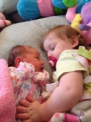 McKenna's new baby doll! Riley Anne is checking out her new, big sister