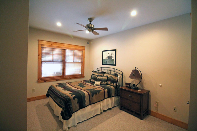 Lower level guest bedroom with entrance to shared full bath;