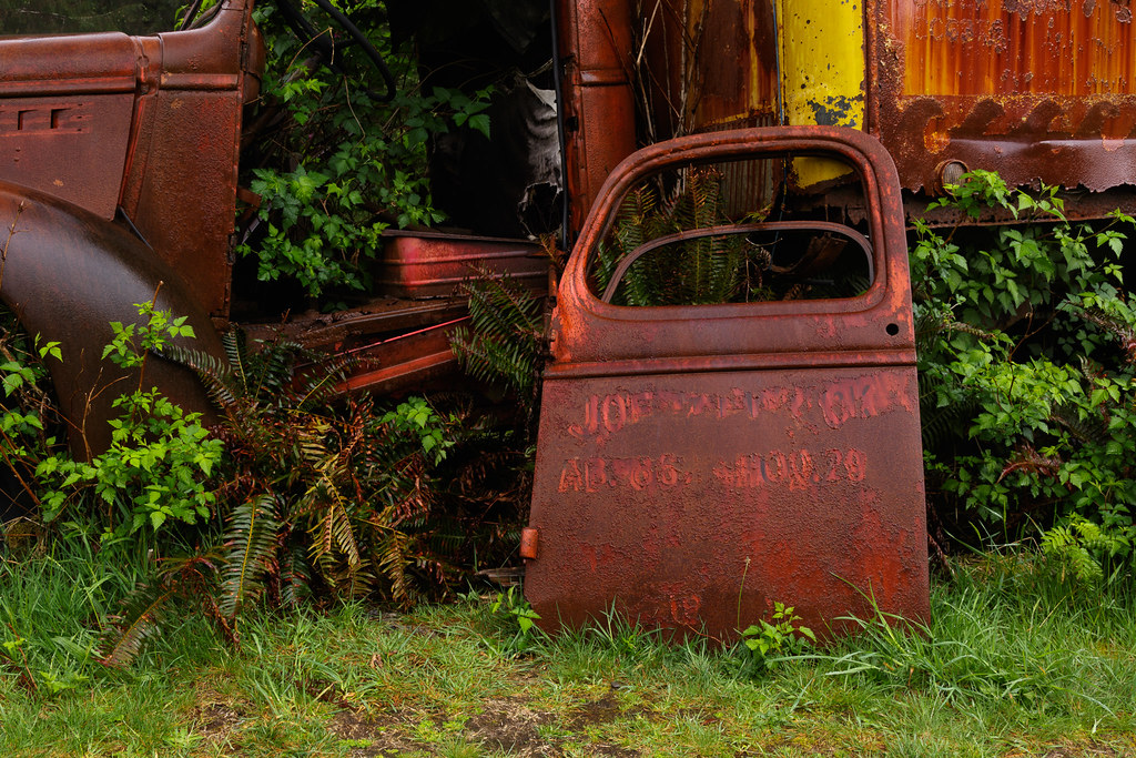 A dilapidated moving van on the Kestner Homestead Trail in the Quinault Rain Forest in Olympic National Park