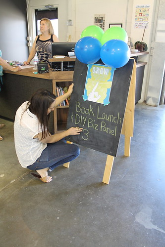 Lauren from Creative Outlet Studios helps with our sign