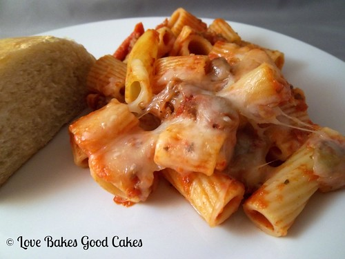 Meaty Pasta Bake with garlic toast on white plate.
