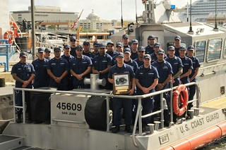 Crewmembers from Coast Guard Station San Juan take a group photo after being presented with the Sumner I. Kimball Readiness Award Sept. 18, 2013 at Coast Guard Sector San Juan, Puerto Rico. Photo by Ricardo Castrodad, Sector San Juan public affairs specialist.