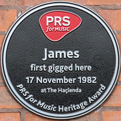 Photo of Tim Booth, James, and The Haçienda black plaque