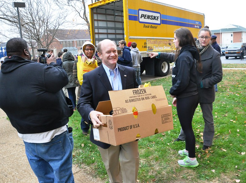 Senator Coons lends a hand at the 31st Annural Norman Oliver Thanksgiving Turkey Drive in Wilmington on November 26, 2013.