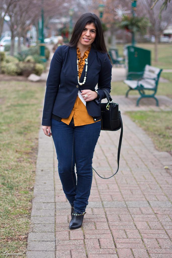 orange ruffled blouse, navy blazer.jpg