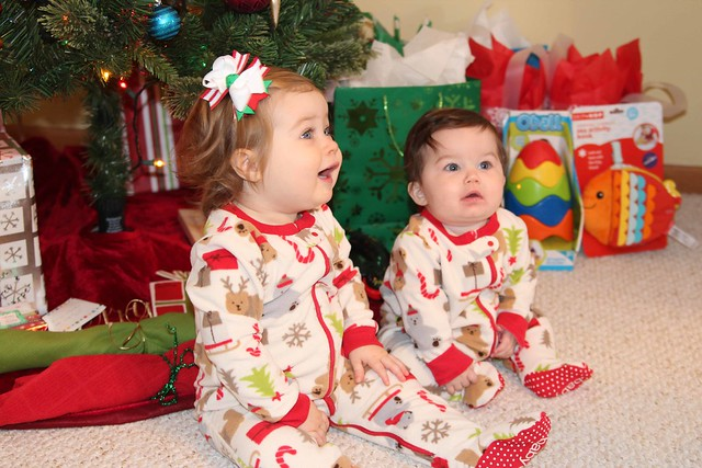 Cousins in matching Christmas jammies