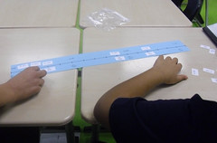 As students place decimal and fraction numbers in order on the number line, they discuss how to compare the numbers. (Feb. 2012, Gr 5)