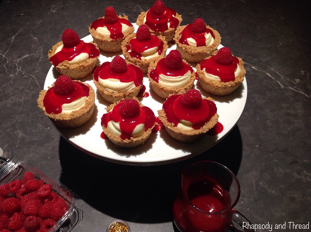Easy No-Bake Mini Raspberry Cheesecakes With Fresh Raspberry and Gold Leaf Decoration by Rhapsody and Thread