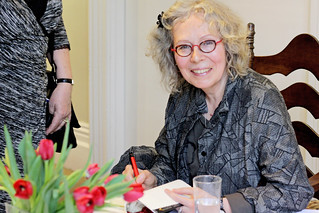 Eva Stachniak smiles as she signs a copy of Empress of the Night for a fan