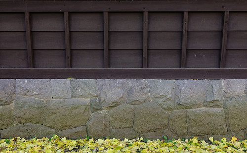Stone and wooden wall of old castle in Tokyo, Japan