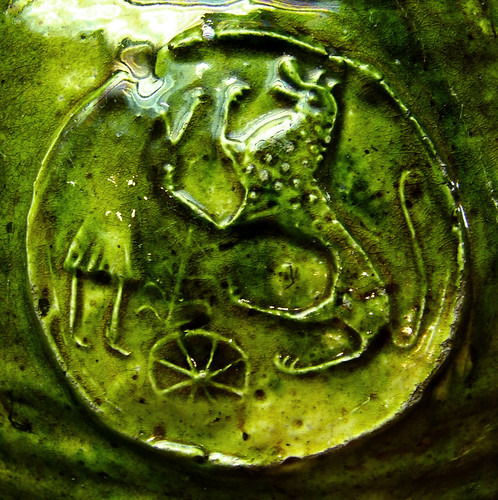Medieval pottery with beast-human interaction