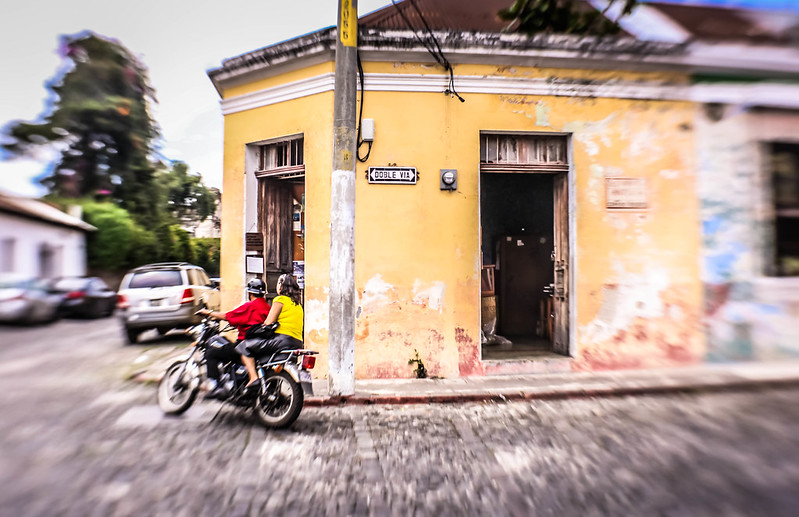 Man and woman on motorcycle in Antigua Guatemala