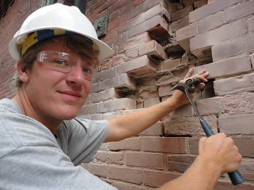 repairing bricks on historic building