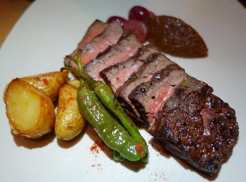 Morsels: The Butcher's Secret - Grilled Bavette Steak, Onion Jam, Shishitos, Pickled Grapes, Fingerling Potatoes & Chimichurri Sauce.
