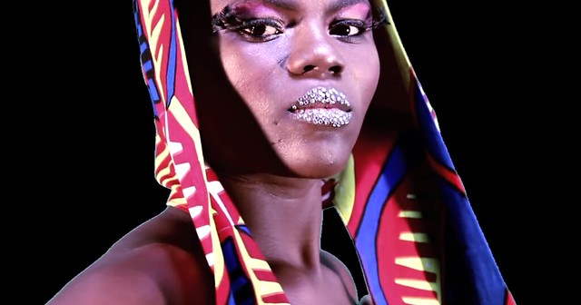 A photo of Wiyalla, a black woman with bright jewels on her lips