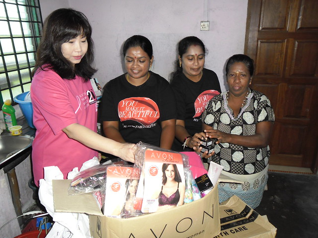 AVON HQ team present donation to Azizah (AVON representative)_edited.jpg