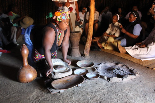 Demonstrating traditional Zulu cooking