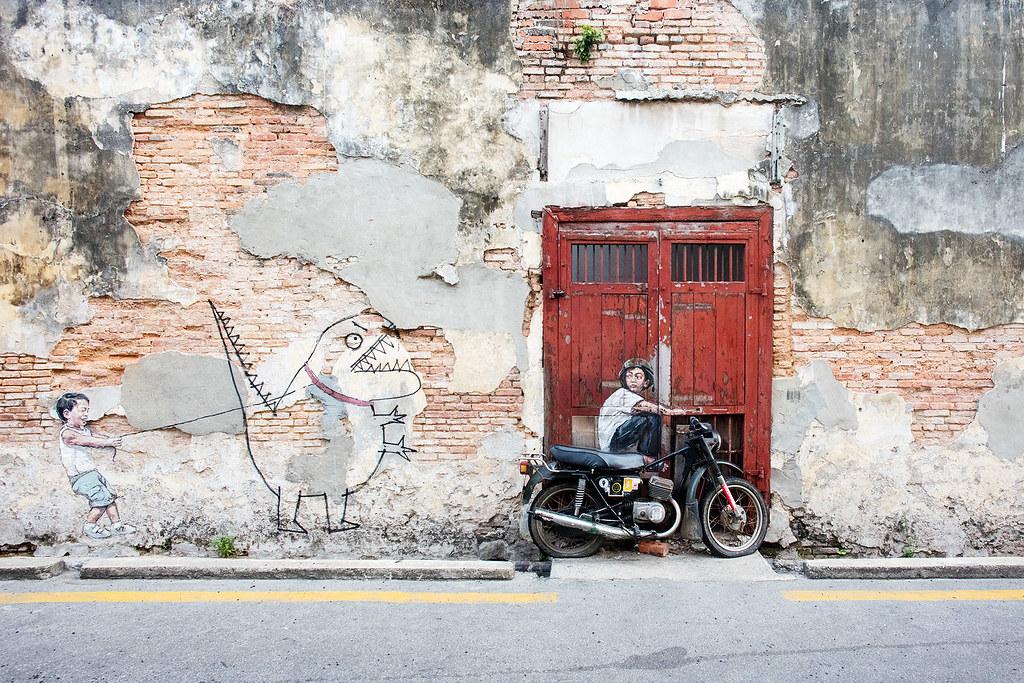 (Left) Little Boy with Pet Dinosaur (Right) Boy on a bike, Artist: (Both) Ernest Zacharevic.