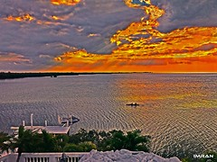 Jet Ski Sits, Kayak Slides, Sunset Sinks, On Tampa Bay - IMRAN™