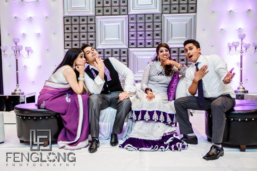 Taking group photos on stage at their Atlanta Ismaili Indian wedding