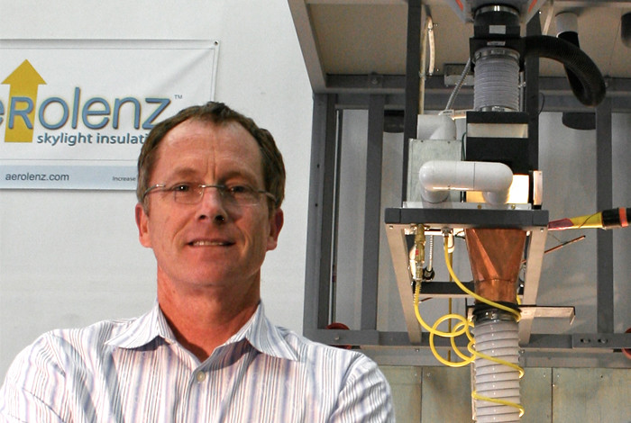 Aerolenz, LLC founder Bill Kurtz stands next to the Aerogel filling apparatus