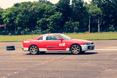 stock car racing(0.0), drifting(0.0), race track(0.0), auto racing(1.0), automobile(1.0), racing(1.0), wheel(1.0), vehicle(1.0), sports(1.0), motorsport(1.0), autocross(1.0), sedan(1.0), land vehicle(1.0), sports car(1.0),