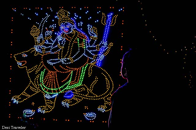 a child in front of Maa Durga