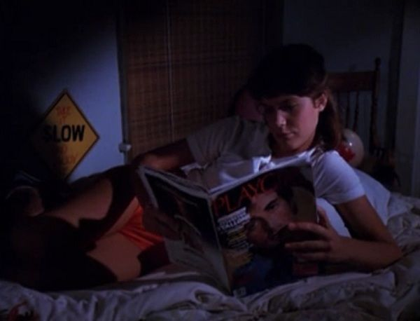Valerie reading alone in bed
