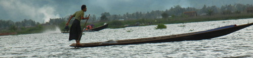 Inle fisherman in approaching storm