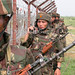 Indian army soldiers patrol near the fencing with Paksiatn near Line of Control or a ceasefire line