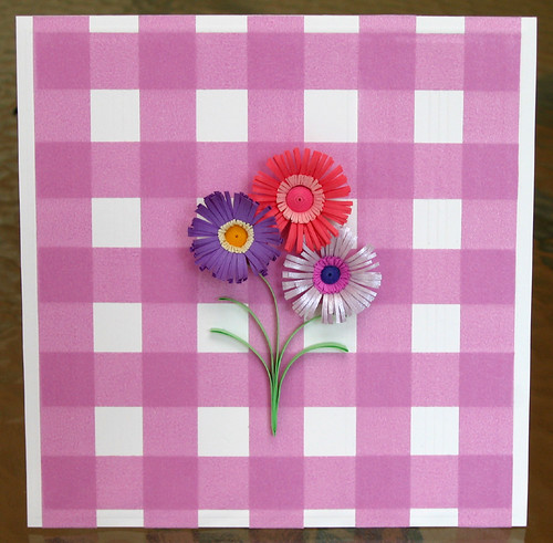 bouquet of large fringed paper flowers on a greeting card with plaid washi tape background