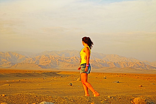yellow desert mountain woman peru andes sunset