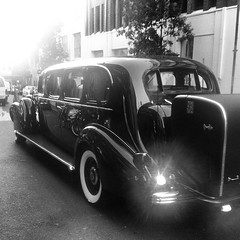 compact car(0.0), automobile(1.0), automotive exterior(1.0), wheel(1.0), vehicle(1.0), automotive design(1.0), monochrome photography(1.0), antique car(1.0), sedan(1.0), vintage car(1.0), land vehicle(1.0), monochrome(1.0), luxury vehicle(1.0), limousine(1.0), black-and-white(1.0), motor vehicle(1.0),
