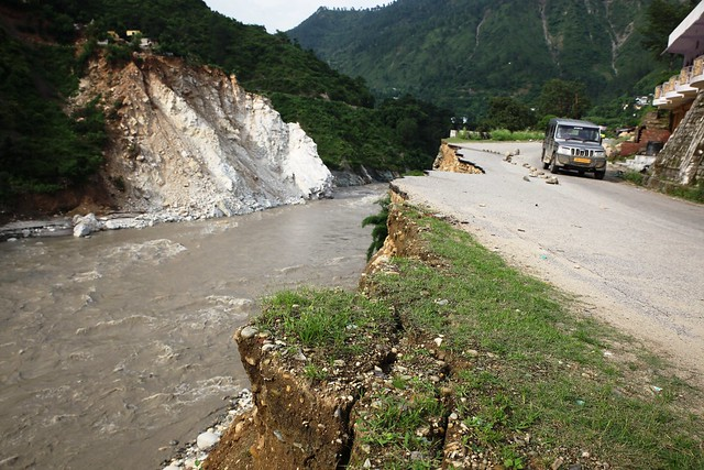 A road damaged by floods 10 km from Rudraprayag town in India's Himalayan state of Uttarakhand. Thousands of homes, roads and bridges in the region are in need of repair after the floods and landslides on June 16 and 17. Credit: Nita Bhalla/Thomson Reuters Foundation.