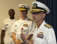 Rear Adm. Hugh D. Wetherald, right, addresses his staff for the first time after relieving Rear Adm. Jeffrey A. Harley, center, as commander of Amphibious Force Seventh Fleet. (U.S. Navy photo by Mass Communication Specialist 1st Class Todd Macdonald)