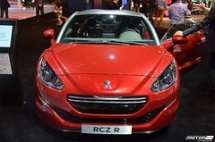 peugeot 308(0.0), peugeot 207(0.0), race car(1.0), automobile(1.0), peugeot(1.0), vehicle(1.0), automotive design(1.0), auto show(1.0), mid-size car(1.0), land vehicle(1.0), luxury vehicle(1.0), supercar(1.0),