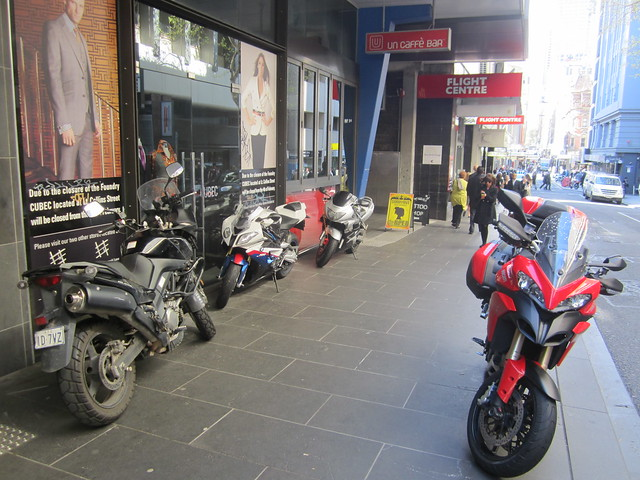 Motorbikes parked along the building line