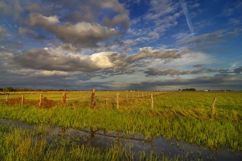 sunset clouds texas dusk woodenfence prairie fenceposts simonton fortbendcounty simontontexas fortbendcountytexas