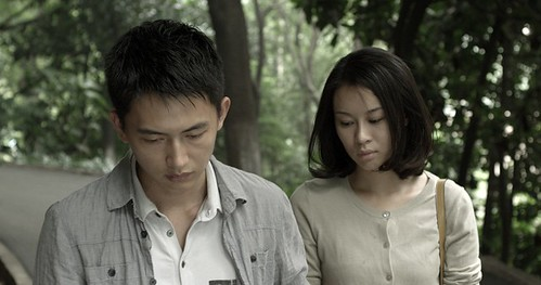 A scene from Trap Street, featuring the young male protagonist on a walk with the young woman he met while out surveilling.