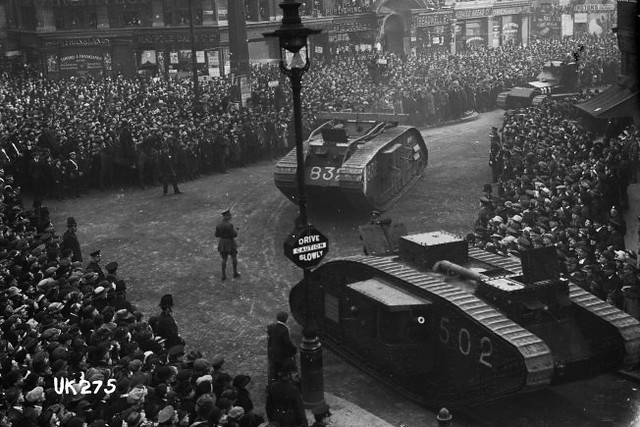 Tanks taking part in a victory parade near Covent Garden to mark the end of World War I, 1918. Photo by Thomas Scales