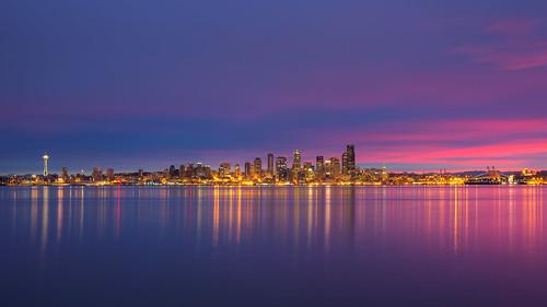 seattle cityscape sunrise elliotbay pugetsound downtown lights reflection canon pacificnorthwest cloudy night canoneos5dmarkiii sigma35mmf14dghsmart johnwestrock washington