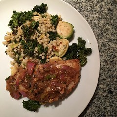 Single girl Wednesday night working dinner cooked up some Za'atar-Spiced Chicken with pink lemon pan sauce (to die for!) and pearl couscous with roasted kale, garlic cloves and Brussels sprouts - now that'll make a girl work real hard :relaxed: