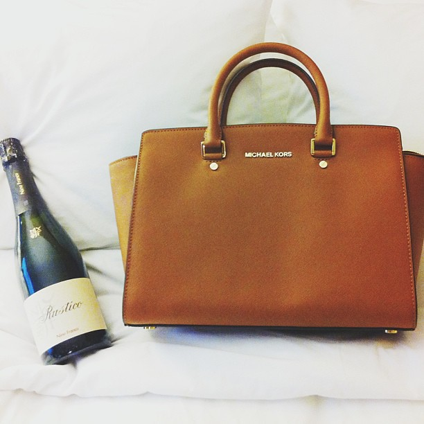 New purse and a free champagne bottle c/o Michael Kors!