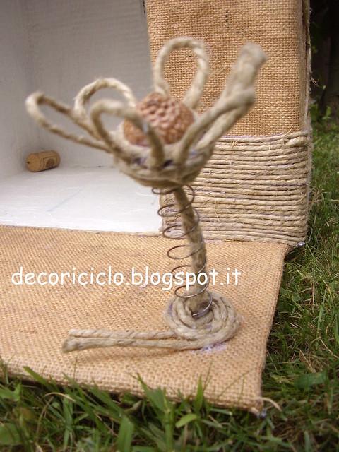 cuccia riciclosa di Gina 7 il fiore sulla molla