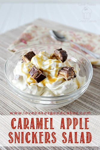 Caramel Apple Snickers Salad in clear bowl with spoon.