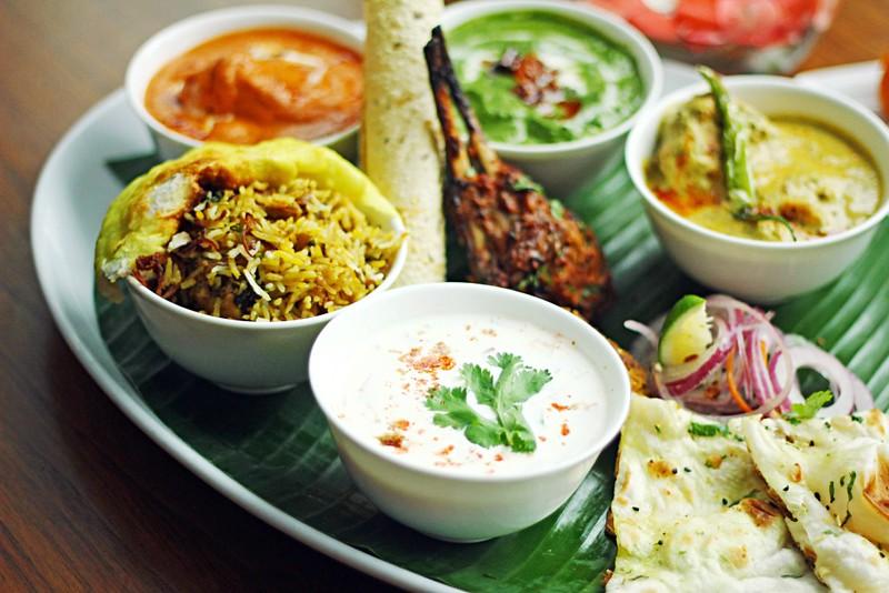 Palak paneer, Murgh makhani, Sorson maach, Naan, Raita, Chicken biryani and Kebabs