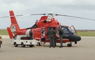 An aircrew from Air Station Corpus Christi engage in conversation with the 46-year-old man, who was hoisted from Corpus Christi Bay Oct. 30, after his sailboat overturned. U.S Coast Guard photograph. - See more at: http://www.uscgnews.com/go/doc/4007/1948498/Coast-Guard-rescues-46-year-old-man-in-Corpus-Christi-Bay#sthash.PMYKapOY.dpuf